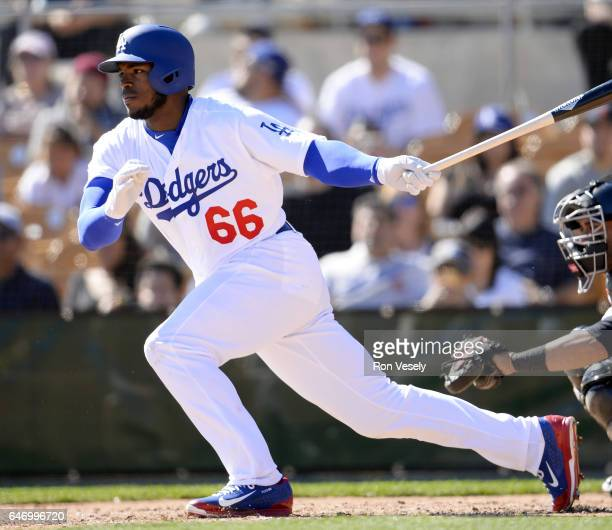 Yasiel Puig of the Los Angeles Dodgers bats during the spring training game against the Chicago White Sox on February 25 2017 at Camelback Ranch in...