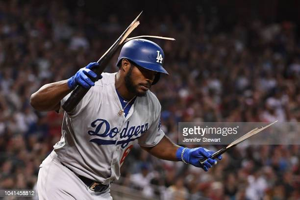 Yasiel Puig of the Los Angeles Dodgers breaks his bat after popping out in the fifth inning of the MLB game against the Arizona Diamondbacks at Chase...