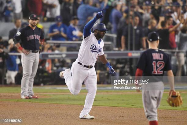 Yasiel Puig of the Los Angeles Dodgers celebrate on his way to second hase after hitting a threerun home run in the sixth inning of Game Four of the...