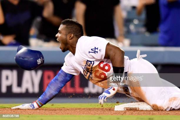 Yasiel Puig of the Los Angeles Dodgers celebrates after hitting a triple in the seventh inning against the Arizona Diamondbacks in game one of the...