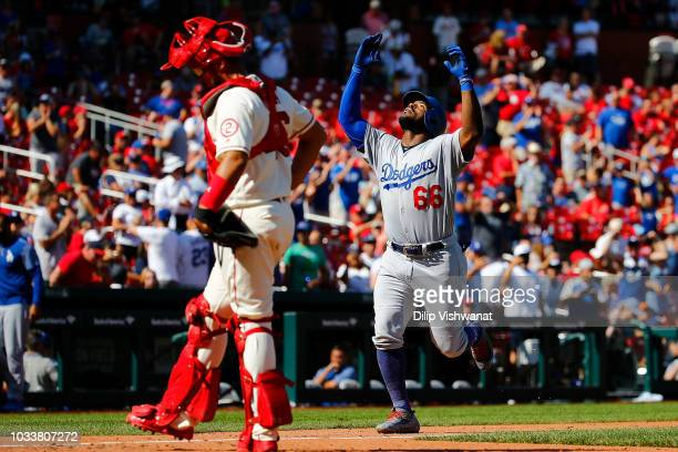 Yasiel Puig of the Los Angeles Dodgers celebrates after hitting a tworun home run against the St Louis Cardinals in the eighth inning at Busch...