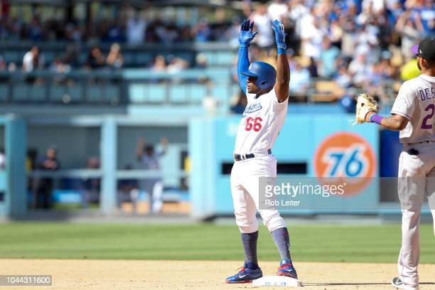 Yasiel Puig of the Los Angeles Dodgers celebrates after hitting a double during the fourth inning against the Colorado Rockies at Dodger Stadium on...