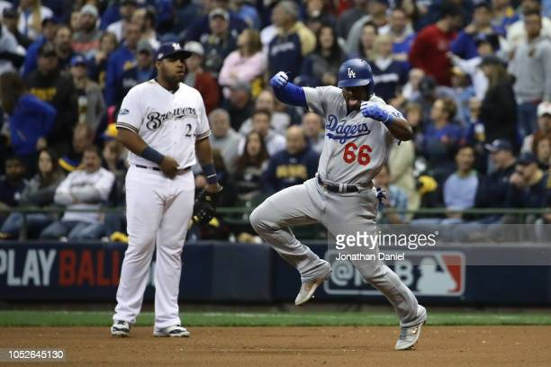 Yasiel Puig of the Los Angeles Dodgers celebrates after hitting a three run home run against Jeremy Jeffress of the Milwaukee Brewers during the...