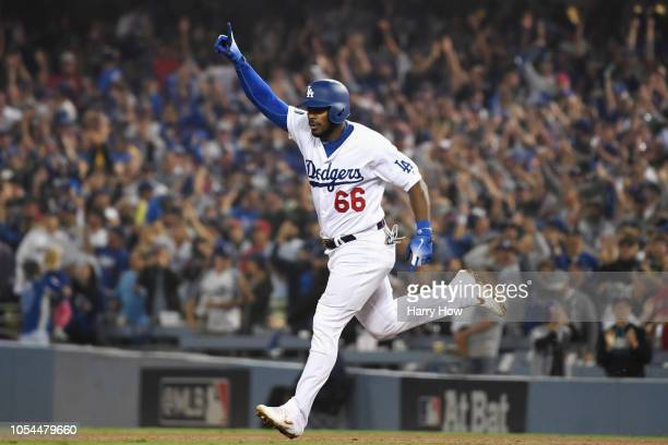 Yasiel Puig of the Los Angeles Dodgers celebrates after hitting a threerun home run to left field in the sixth inning of Game Four of the 2018 World...