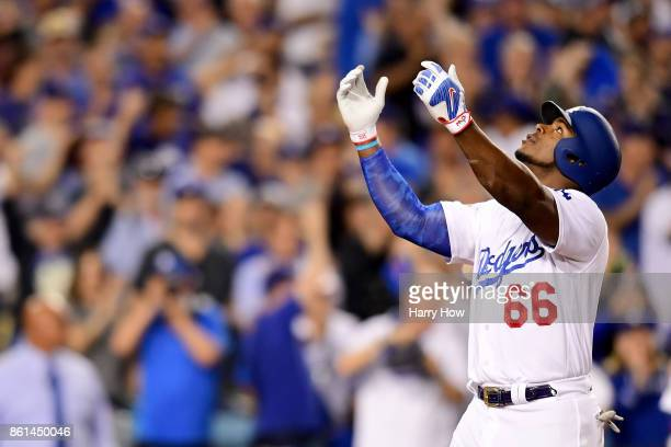 Yasiel Puig of the Los Angeles Dodgers celebrates after hitting a solo home run against Mike Montgomery of the Chicago Cubs during the seventh inning...