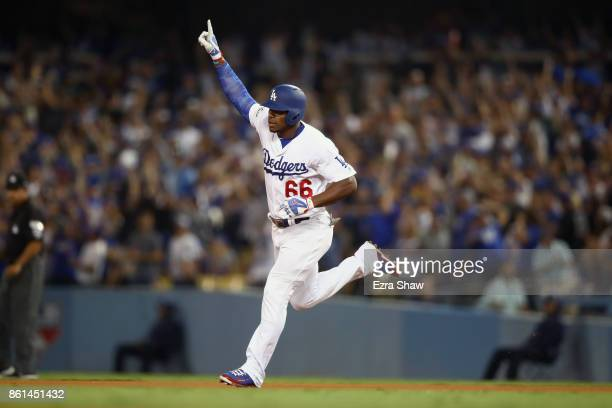 Yasiel Puig of the Los Angeles Dodgers celebrates after hitting a home run in the bottom of the seventh inning during Game One of the National League...