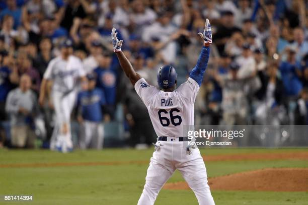 Yasiel Puig of the Los Angeles Dodgers celebrates after hitting a double to center field to score Logan Forsythe against Jose Quintana of the Chicago...