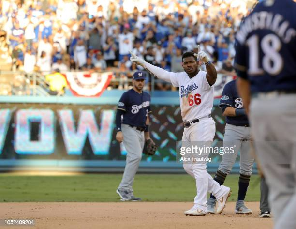 Yasiel Puig of the Los Angeles Dodgers celebrates after reaching second in the eighth inning of Game 5 of the NLCS against the Milwaukee Brewers at...