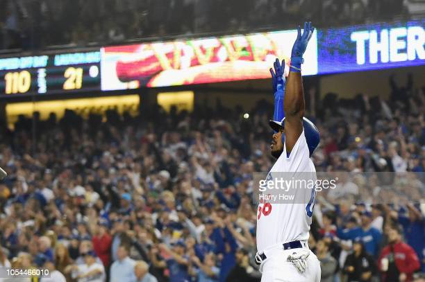 Yasiel Puig of the Los Angeles Dodgers celebrates as his hit goes for a threerun home run to left field in the sixth inning of Game Four of the 2018...