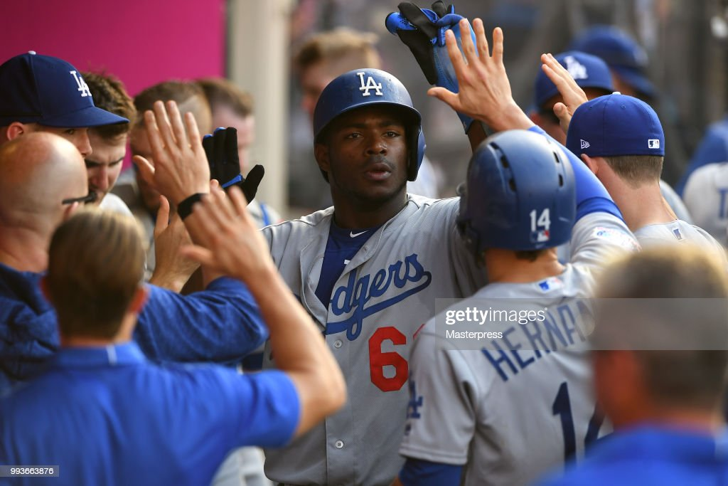 Yasiel Puig #66 of the Los Angeles Dodgers celebrates during the MLB game against the Los Angeles Angels of Anaheim at Angel Stadium on July 7, 2018 in Anaheim, California.
