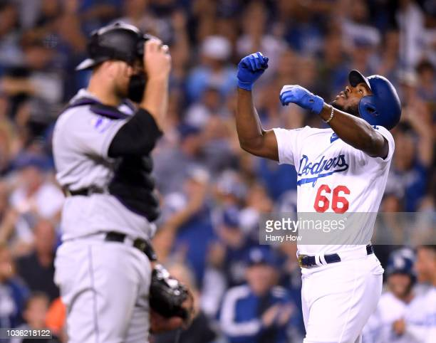 Yasiel Puig of the Los Angeles Dodgers celebrates his three run homerun in front of Clayton Kershaw of the Los Angeles Dodgers to take a 52 lead...