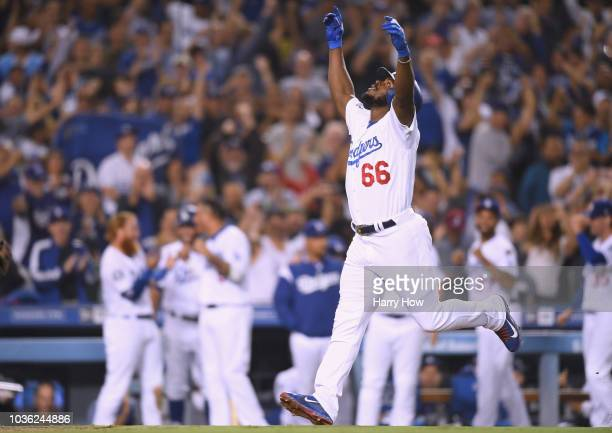 Yasiel Puig of the Los Angeles Dodgers celebrates his three run homerun to take a 52 lead over the Colorado Rockies during the seventh inning at...