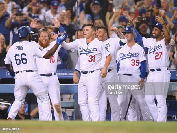 Yasiel Puig of the Los Angeles Dodgers celebrates his three run homerun with Justin Turner Joc Pederson and Manny Machado to take a 52 lead over the...
