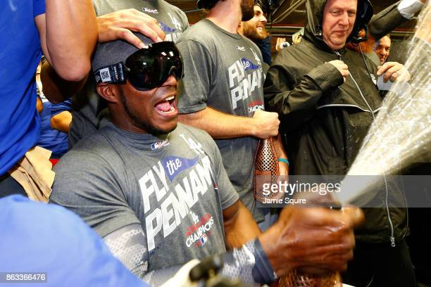 Yasiel Puig of the Los Angeles Dodgers celebrates in the clubhouse after defeating the Chicago Cubs 111 in game five of the National League...