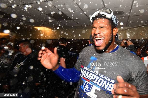 Yasiel Puig of the Los Angeles Dodgers celebrates in the locker room after defeating the Milwaukee Brewers in Game Seven to win the National League...