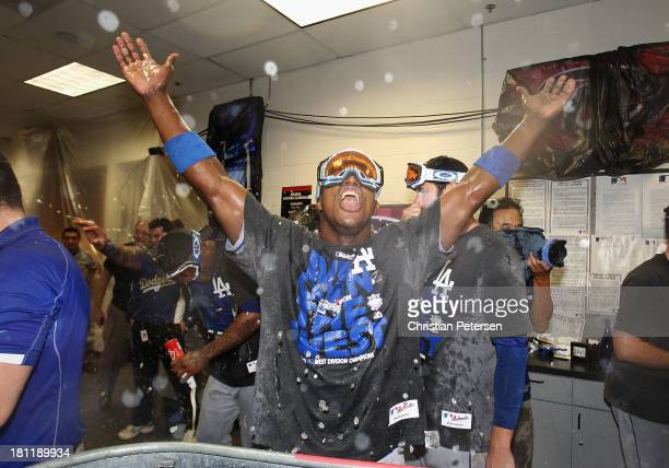 Yasiel Puig of the Los Angeles Dodgers celebrates in the locker room after defeating the Arizona Diamondbacks to clinch the National League West...