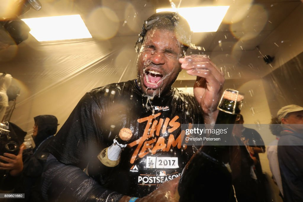 Yasiel Puig #66 of the Los Angeles Dodgers celebrates in the locker room after defeating the Arizona Diamondbacks 3-1 to win game three of the National League Divisional Series at Chase Field on October 9, 2017 in Phoenix, Arizona.