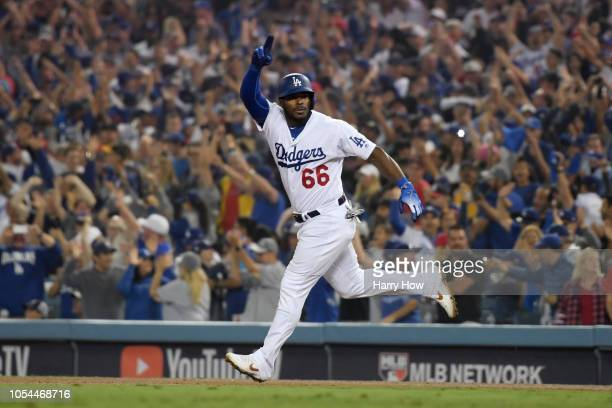 Yasiel Puig of the Los Angeles Dodgers celebrates on his way to second base after hitting a threerun home run to left field in the sixth inning of...