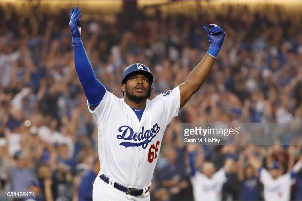 Yasiel Puig of the Los Angeles Dodgers celebrates on his way to first base after hitting a threerun home run to left field in the sixth inning of...