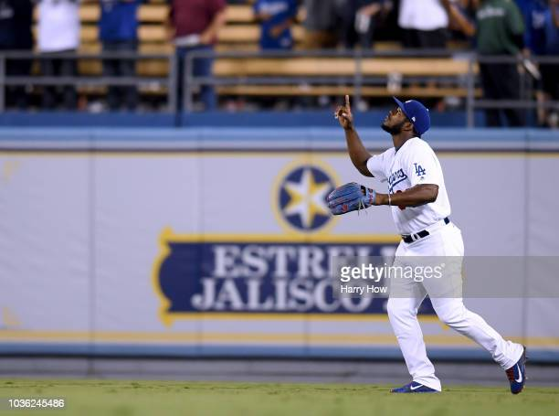 Yasiel Puig of the Los Angeles Dodgers celebrates the final out and a 52 win over the Colorado Rockies at Dodger Stadium on September 19 2018 in Los...