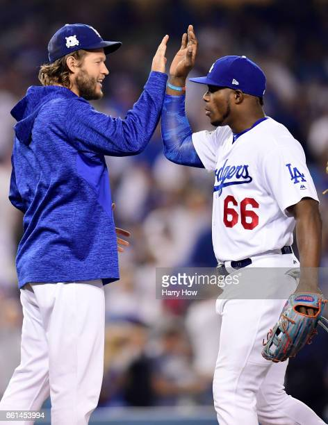 Yasiel Puig of the Los Angeles Dodgers celebrates with Clayton Kershaw after defeating the Chicago Cubs in Game One of the National League...