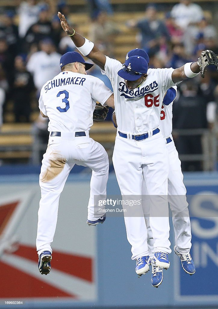 Yasiel Puig #66 of the Los Angeles Dodgers celebrates with fellow outfielders Skip Schumaker #3 and Andre Ethier #16 after the game with the San Diego Padres at Dodger Stadium on June 4, 2013 in Los Angeles, California. (Photo by Stephen Dunn/Getty Images) The Dodgers won 9-7.