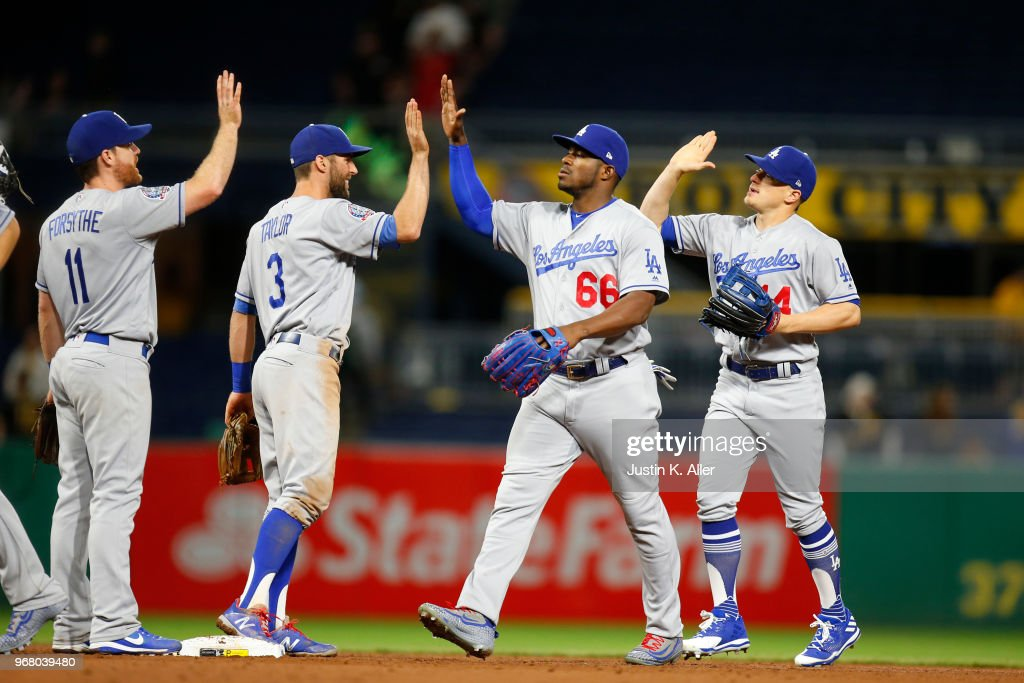 Yasiel Puig #66 of the Los Angeles Dodgers celebrates with teammates after defeating the Pittsburgh Pirates 5-0 at PNC Park on June 5, 2018 in Pittsburgh, Pennsylvania.