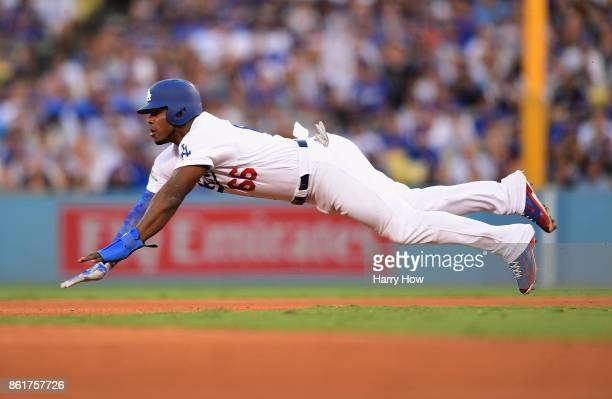 Yasiel Puig of the Los Angeles Dodgers dives as he attempts to steal second base in the fourth inning against the Chicago Cubs during game two of the...