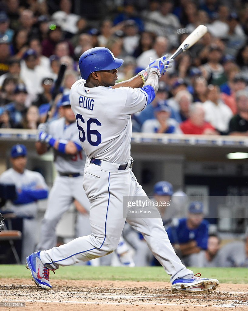 Yasiel Puig #66 of the Los Angeles Dodgers hits a double during the sixth inning of a baseball game against the San Diego Padres at PETCO Park on September 29, 2016 in San Diego, California.
