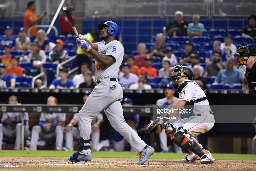 Yasiel Puig #66 of the Los Angeles Dodgers hits a home run in the seventh inning against the Miami Marlins at Marlins Park on May 15, 2018 in Miami, Florida.