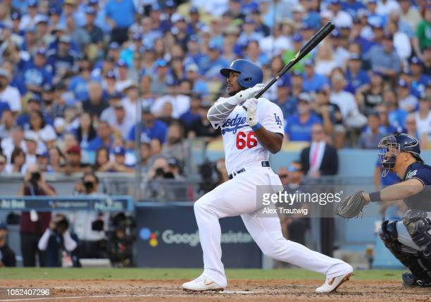Yasiel Puig of the Los Angeles Dodgers hits a RBI single in the sixth inning of Game 5 of the NLCS against the Milwaukee Brewers at Dodger Stadium on...