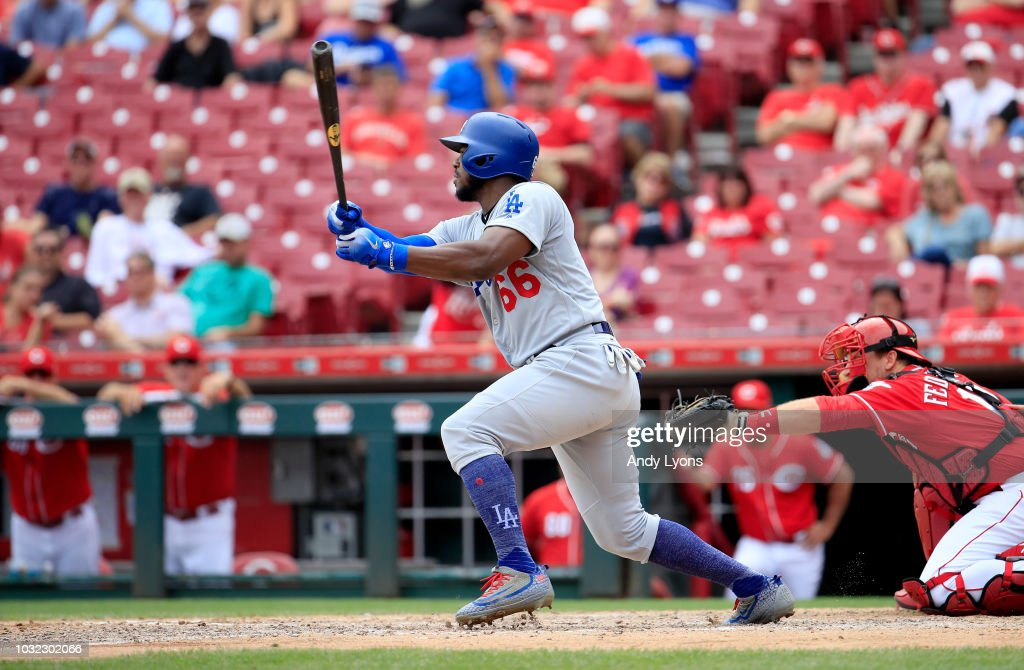 Yasiel Puig #66 of the Los Angeles Dodgers hits a single in the 9th inning against the Cincinnati Reds at Great American Ball Park on September 12, 2018 in Cincinnati, Ohio.
