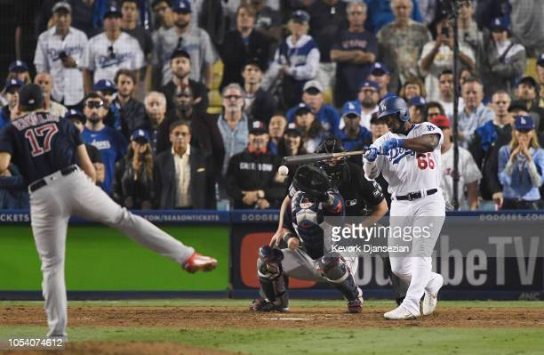 Yasiel Puig of the Los Angeles Dodgers hits a single on a pitch from Nathan Eovaldi of the Boston Red Sox that leads to the tying run during the...