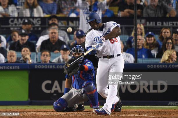 Yasiel Puig of the Los Angeles Dodgers hits a solo home run against Mike Montgomery of the Chicago Cubs during the seventh inning in Game One of the...