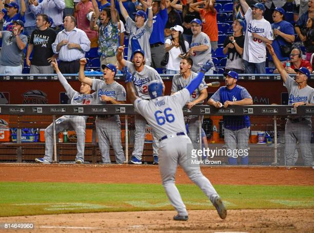 Yasiel Puig of the Los Angeles Dodgers hits a three run go ahead homer in the ninth inning during the game between the Miami Marlins and the Los...