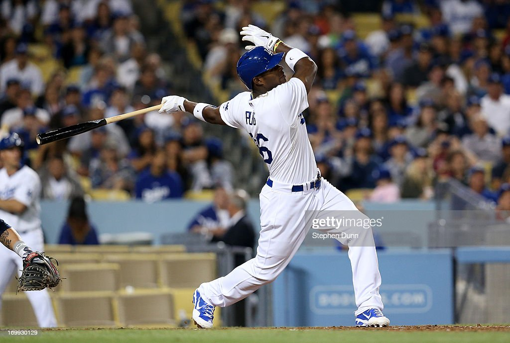 Yasiel Puig #66 of the Los Angeles Dodgers hits a three run home run in the fifth inning to tie the score with the San Diego Padres at Dodger Stadium on June 4, 2013 in Los Angeles, California.