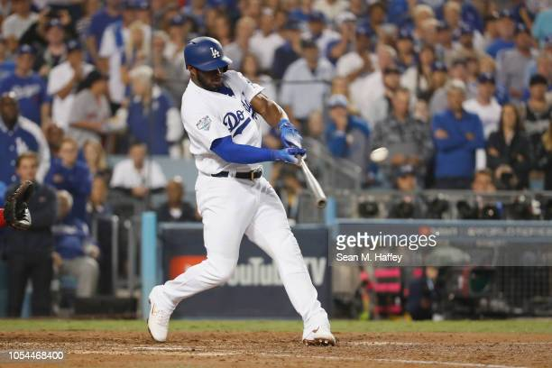 Yasiel Puig of the Los Angeles Dodgers hits a threerun home run in the sixth inning of Game Four of the 2018 World Series against pitcher Eduardo...
