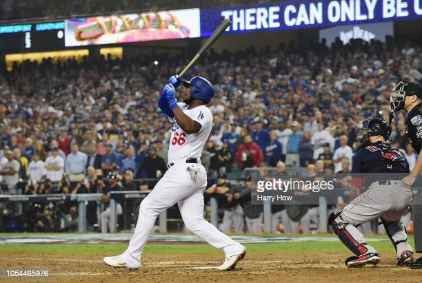 Yasiel Puig of the Los Angeles Dodgers hits a threeun home run in the sixth inning of Game Four of the 2018 World Series against pitcher Eduardo...