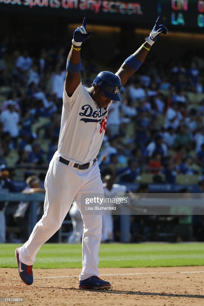 Yasiel Puig #66 of the Los Angeles Dodgers hits a walk off homerun in the eleventh inning to defeat the Cincinnati Reds 1-0 at Dodger Stadium on July 28, 2013 in Los Angeles, California.