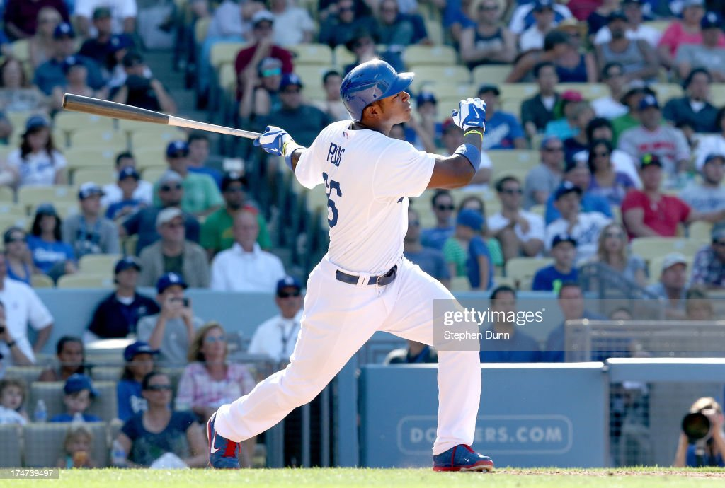 Yasiel Puig #66 of the Los Angeles Dodgers hits a walk off solo home run in the 11th inning against the Cincinnati Reds at Dodger Stadium on July 28, 2013 in Los Angeles, California. The dsosdgers won 1-0 in 11 innings.