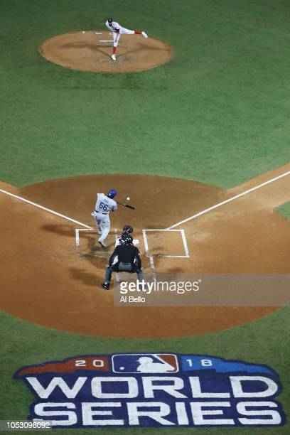 Yasiel Puig of the Los Angeles Dodgers hits an RBI single during the fourth inning on a pitch from David Price of the Boston Red Sox in Game Two of...