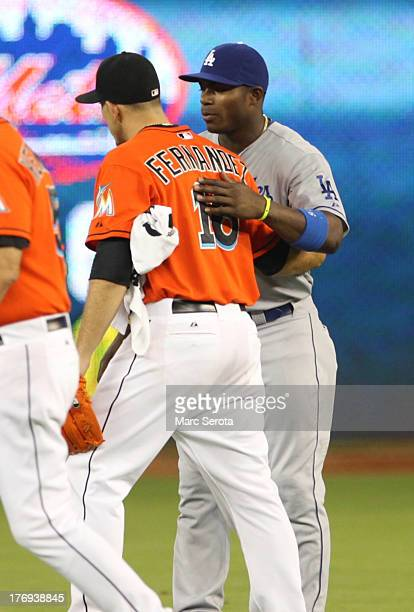 Yasiel Puig of the Los Angeles Dodgers hugs Pitcher Jose Fernandez of the Miami Marlins at Marlins Park on August 19 2013 in Miami Florida