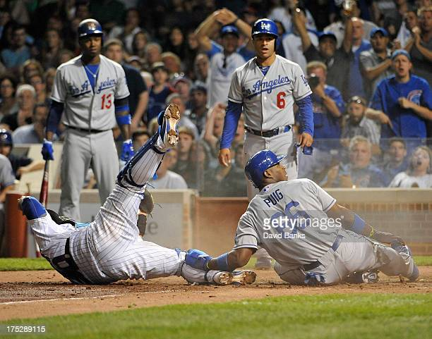 Yasiel Puig of the Los Angeles Dodgers is tagged out at home plate by Dioner Navarro of the Chicago Cubs during the sixth inning on August 1 2013 at...