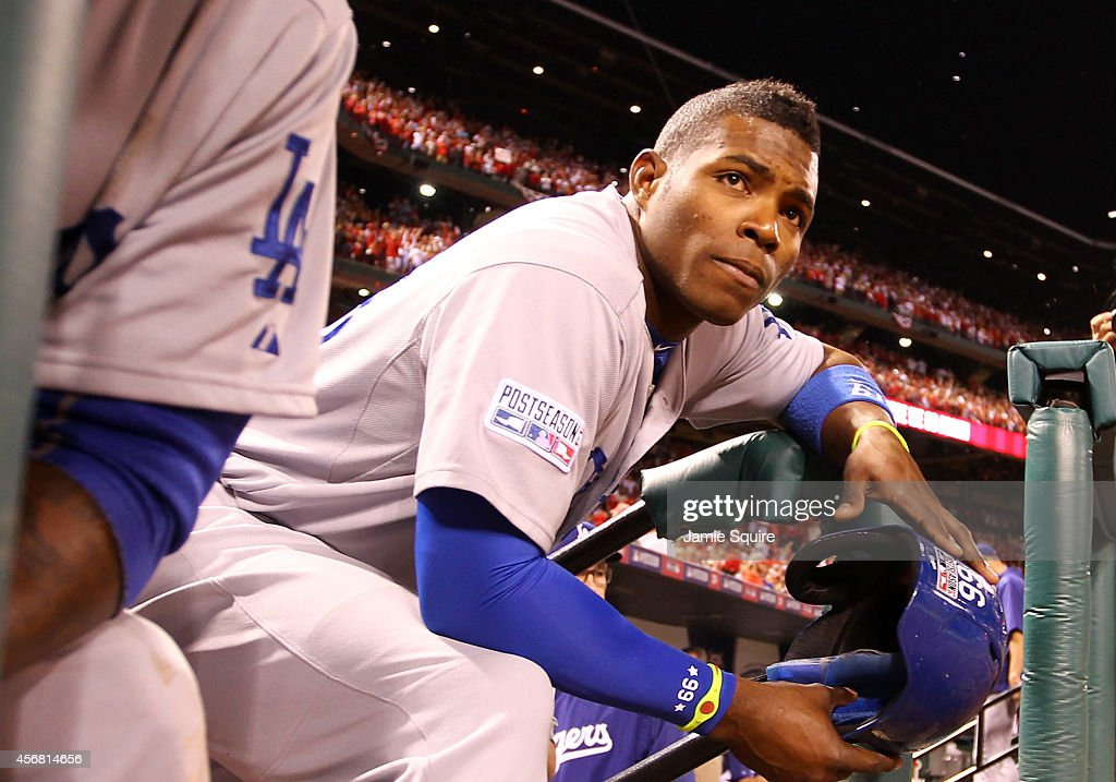Yasiel Puig #66 of the Los Angeles Dodgers looks on from the dugout steps after being defeated by the St. Louis Cardinals in Game Four of the National League Divison Series at Busch Stadium on October 7, 2014 in St Louis, Missouri.