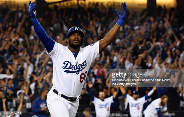Yasiel Puig of the Los Angeles Dodgers looks to the sky after hitting a three run home run against the Boston Red Sox in the sixth inning during game...