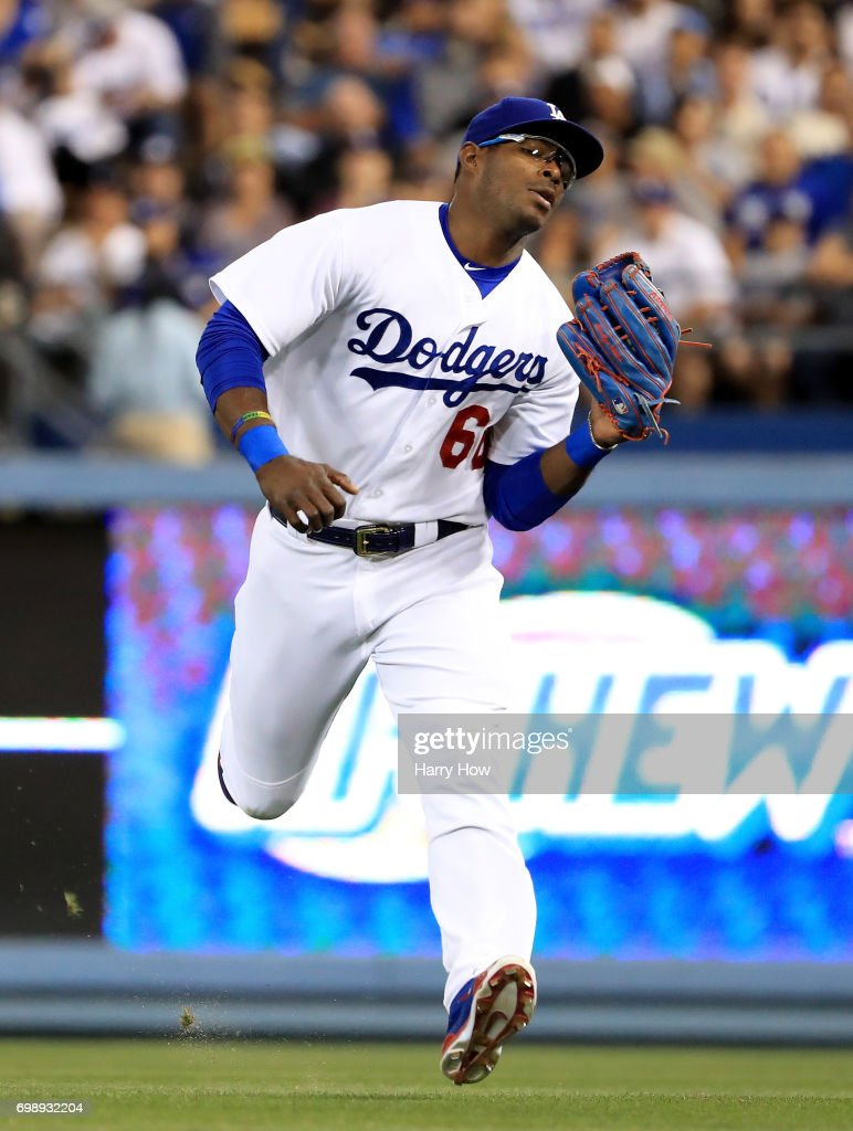 Yasiel Puig #66 of the Los Angeles Dodgers makes a catch during the game against the San Francisco Giants at Dodger Stadium on May 1, 2017 in Los Angeles, California.
