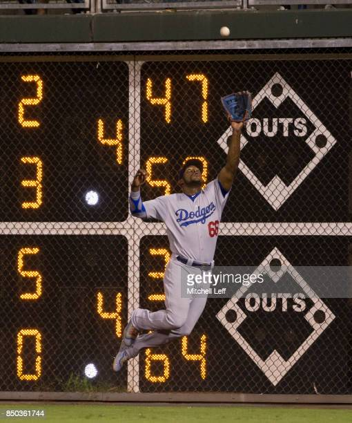Yasiel Puig of the Los Angeles Dodgers makes a leaping catch on a ball hit by Aaron Altherr of the Philadelphia Phillies in the bottom of the fourth...
