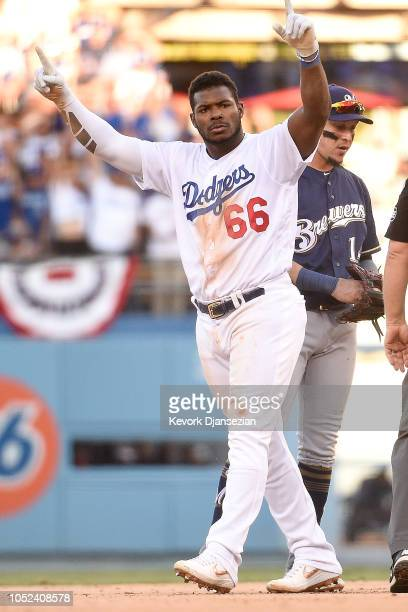 Yasiel Puig of the Los Angeles Dodgers reacts after hitting a double during the eighth inning against the Milwaukee Brewers in Game Five of the...