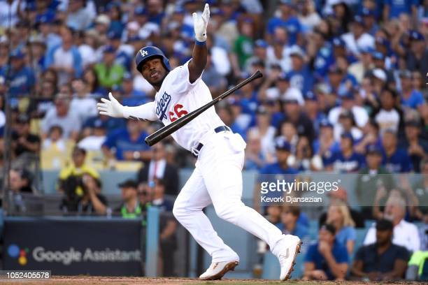 Yasiel Puig of the Los Angeles Dodgers reacts after hitting a RBI single in the sixth inning against the Milwaukee Brewers in Game Five of the...