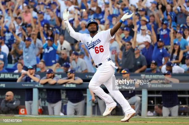 Yasiel Puig of the Los Angeles Dodgers reacts after hitting a RBI single in the sixth inning of Game 5 of the NLCS against the Milwaukee Brewers at...